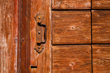 brass brown knocker and wood  door cairate varese italy
