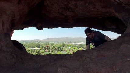 Tourist Inside Hole in the Rock at Papago Park. Arizona, USA.