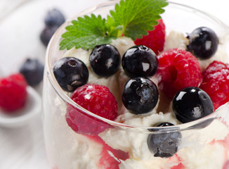 Dessert with berries and mint leaf. Selective focus