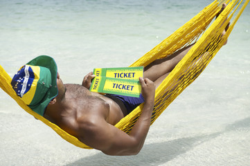 Brazilian Man Relaxing with Brazil Tickets