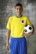 Smiling Young Brazilian Soccer Player Holding Football