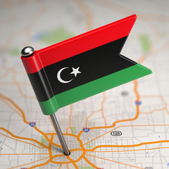 Libya Small Flag on a Map Background.