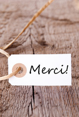 Merci Label on Wood