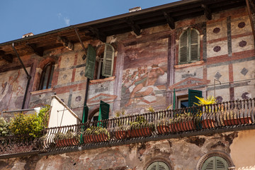 Italy, Verona, old building with a balcony and ancient frescoes