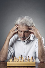 Senior man studying the chessboard