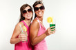 two girls with a drink, portrait in studio, white background.