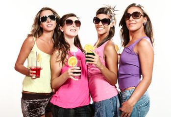 four girls with a drink, portrait in studio, white background