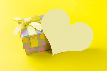 Yellow gift box with plain card