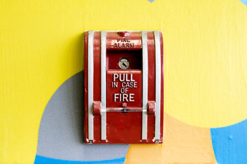 fire alarm box mounted on colorful wall