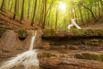 Woman practices yoga in nature.