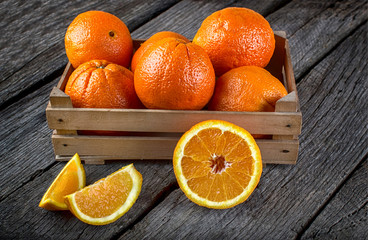 fresh and ripe orange fruits on a wooden table