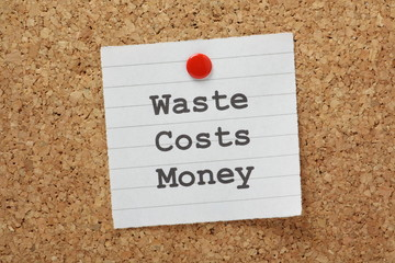 Waste Costs Money  reminder on a cork notice board