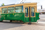 Tram Passing on the Road in Helsinki