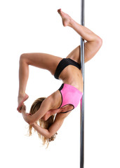 Flexible female dancer balancing on pole