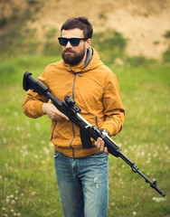 A man with an automatic rifle