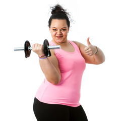 Overweight fitness girl doing thumbs up.
