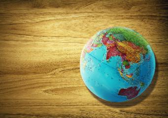 asia globe on desk
