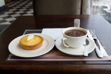 Lemon tart and hot chocolate