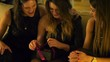 Woman gets gift from her girlfriends on hen party, slow motion