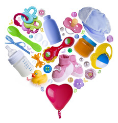 Baby accesories arranged in a heart shape