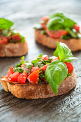 Italian tomato bruschetta with chopped vegetables