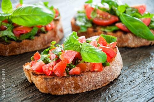 Foto op Aluminium Snack Italian tomato bruschetta with chopped vegetables