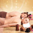 Couple lying on the massage desks.