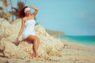 Fashion woman relaxing on the beach