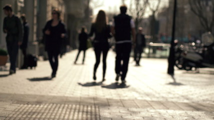 Silhouette of people walking in the city, super slow motion