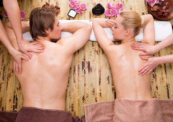 Beautiful couple getting deep back massage.