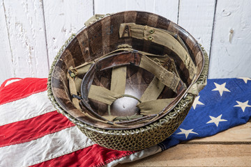 military helmet on an American Flag