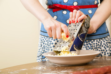 Woman pretty soft hands chopping cheese