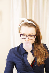 Woman blewing bubble while doing somethink