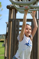 Happy child in play ground exercise