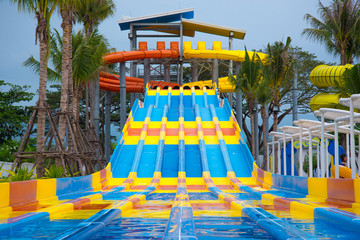 Slider in a variety of colors in the water park