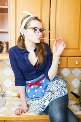 Woman on kitchen furniture play with noodle