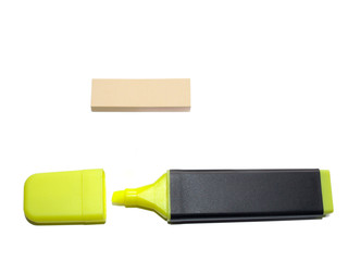 Luminous yellow highlighter with post-it on white background