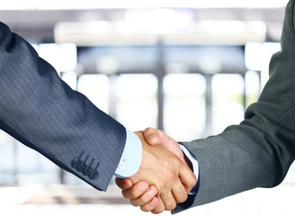 Closeup of a business hand shake between two colleagues
