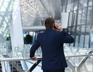back view of a business man talking on his smartphone