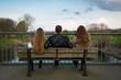 canvas print picture - drei personen auf einer parkbank