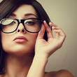 Beautiful sexy woman in fashion glasses looking. Vintage