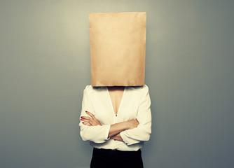 woman hiding under empty paper bag