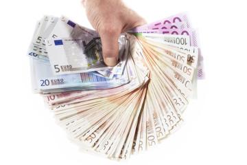 Euroscheine in Hand gehalten