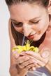 canvas print picture - Frau hält gelbe Lilie