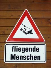 """Warnschild """"fliegende Menschen"""""""