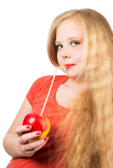 Attractive teen girl in the orange t-shirt holding an red apple