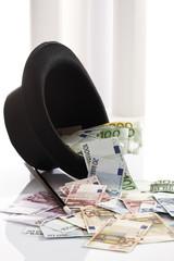 Verschiedene Euro-Banknoten,Top -Hut und Zauberstab