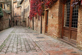 picturesque quiet brick alley in small town Certaldo Alto - 65209882