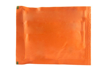 Orange sachet on white background