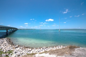 Shoreline of the Florida Keys with pretty blue sky and clouds.